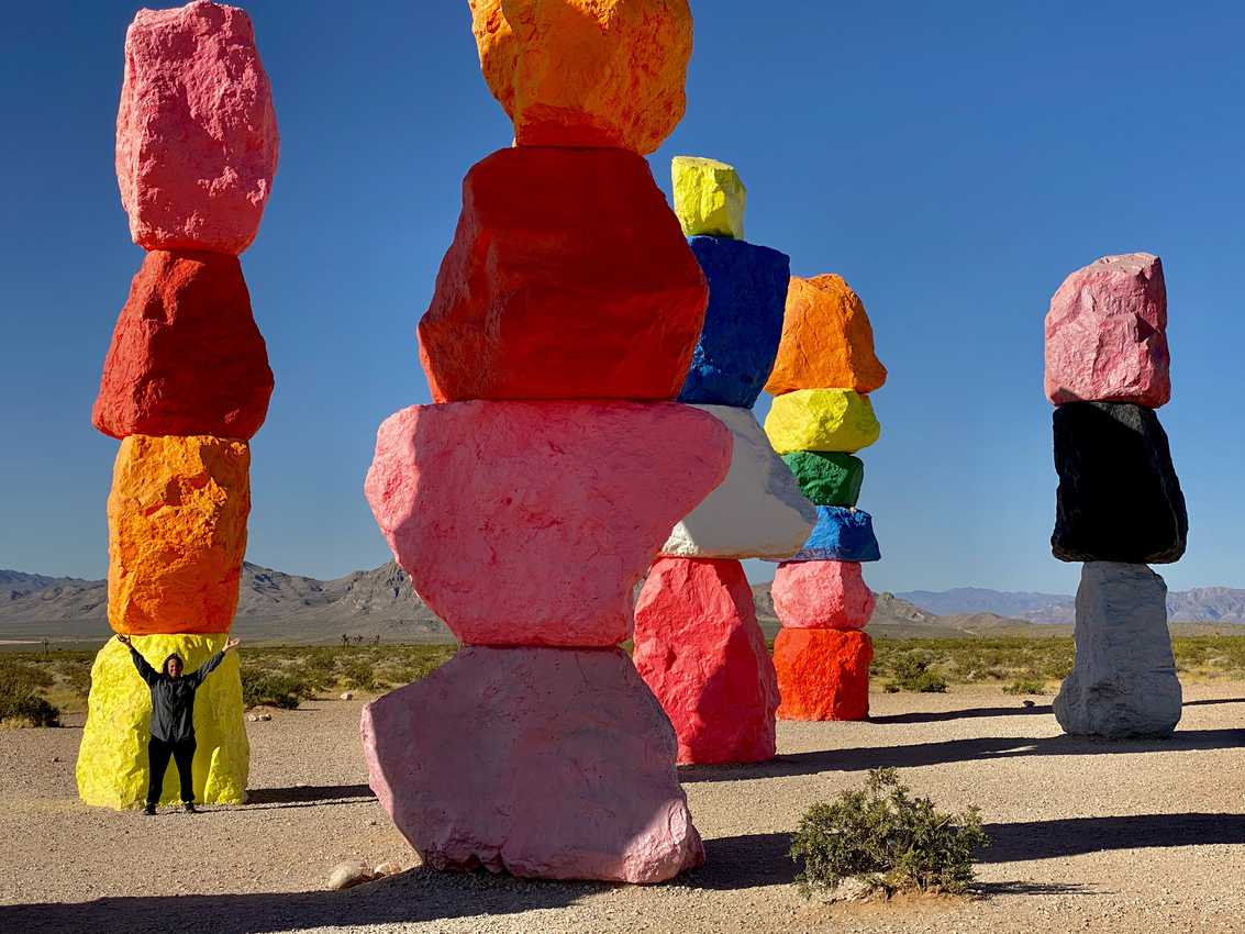 Closing in on home and out in the empty desert near Las Vegas, Seven Magic Mountains, a rainbow of colorfully stacked boulders seem to trumpet the creativity of its creator while offering an uplifting sense of playful hope amongst a drab pandemic doldrum.