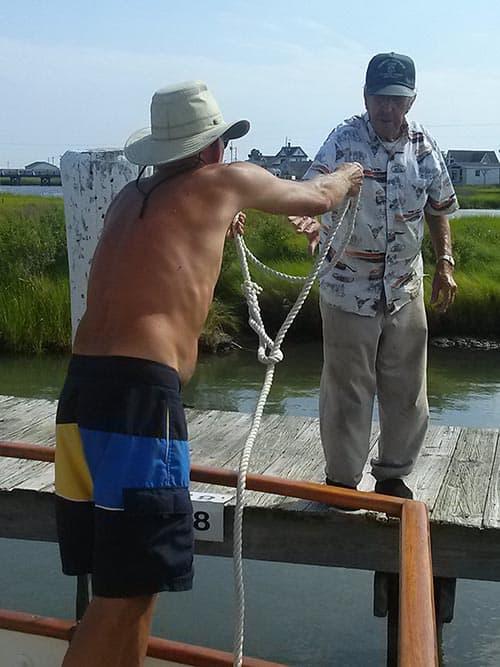 men at wharf