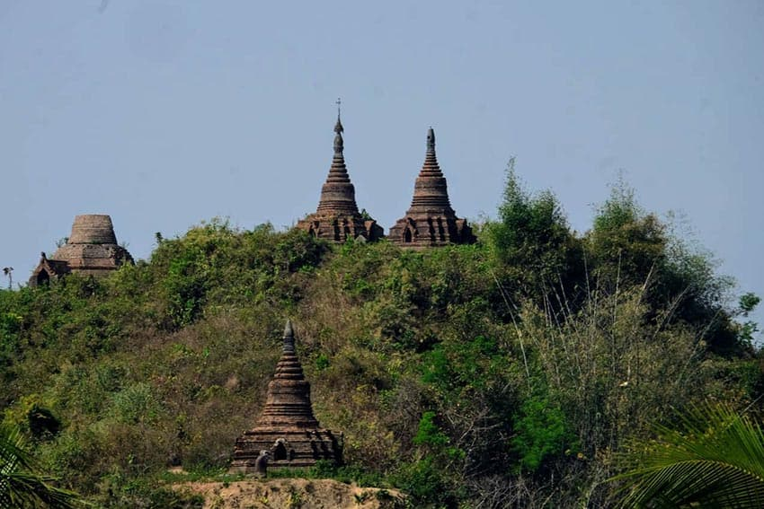 stupas on a hill