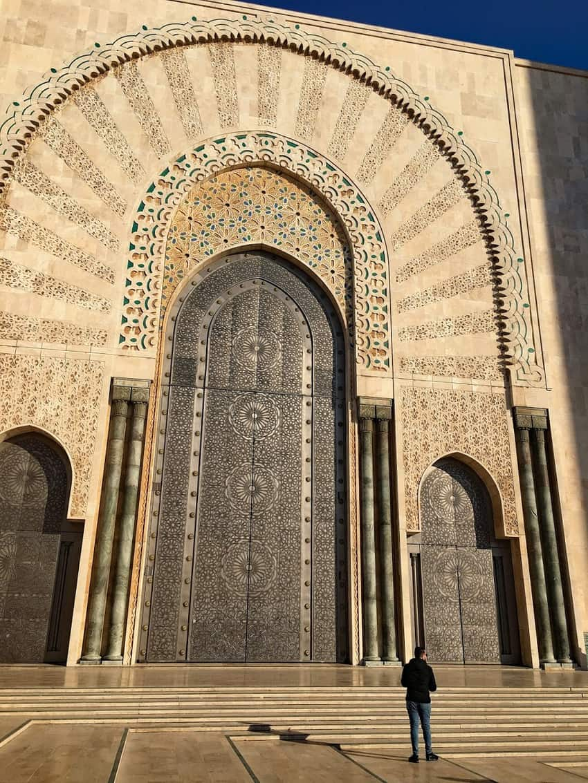 Zellige mosaic tiles adorn the exterior of the Hassan II Mosque designed by a French architect and opened in 1993. It's a must-see in Casablanca, Morocco.