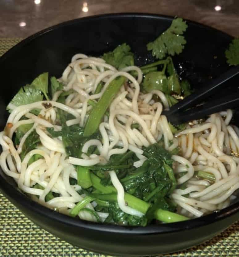 Breakfast in China: Noodles with so many veggies and toppings.