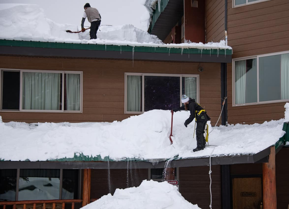 Snow removal of roofs is necessary in Cooke City to avoid having the roof collapse under the weight of the snow.