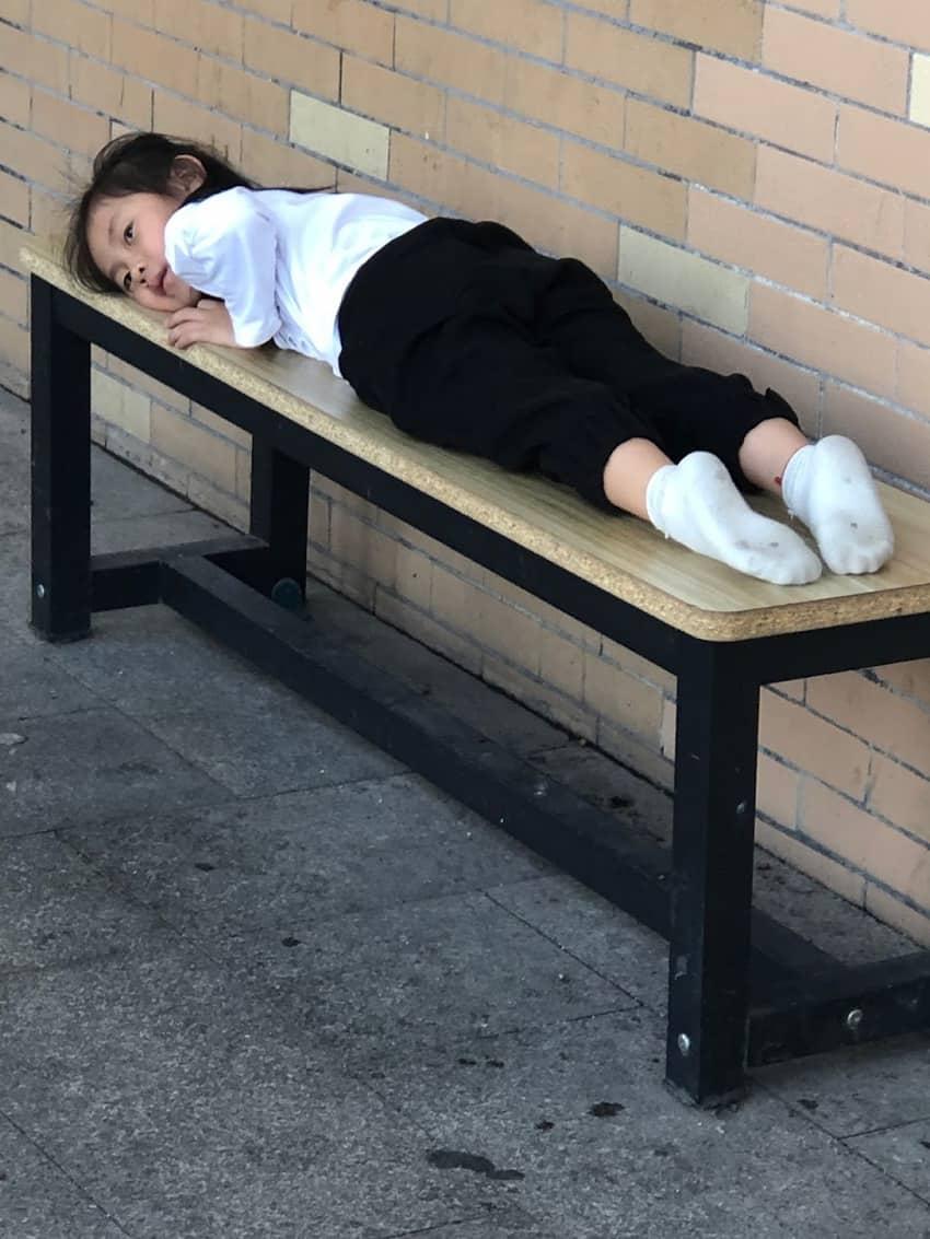 girl at the bus depot