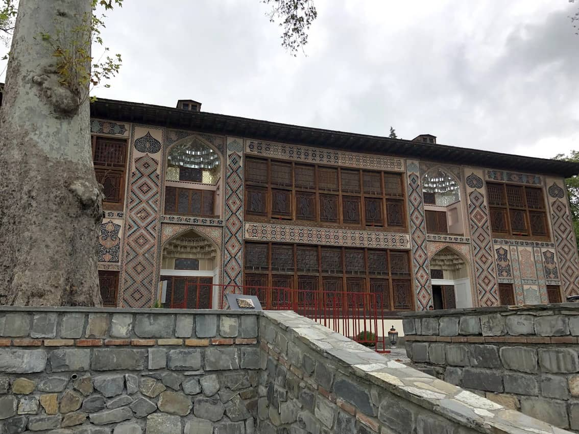 Sheki's famous palace of the Khans near and old tree inside the fortress complex. Recently declared a UNESCO heritage site in August of 2019