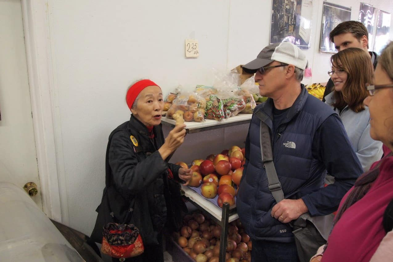 Dorothy explains the many healing properties of ginger at a local market in Chinatown.