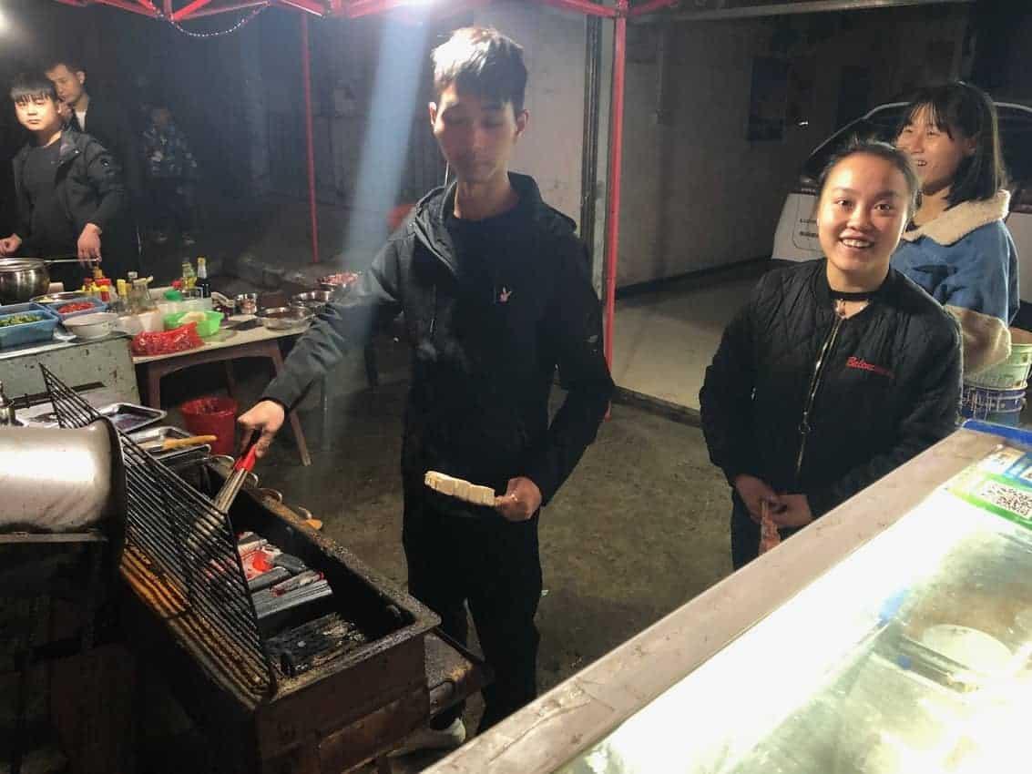 Grilled squid and tofu vendors in Shoashan, China.