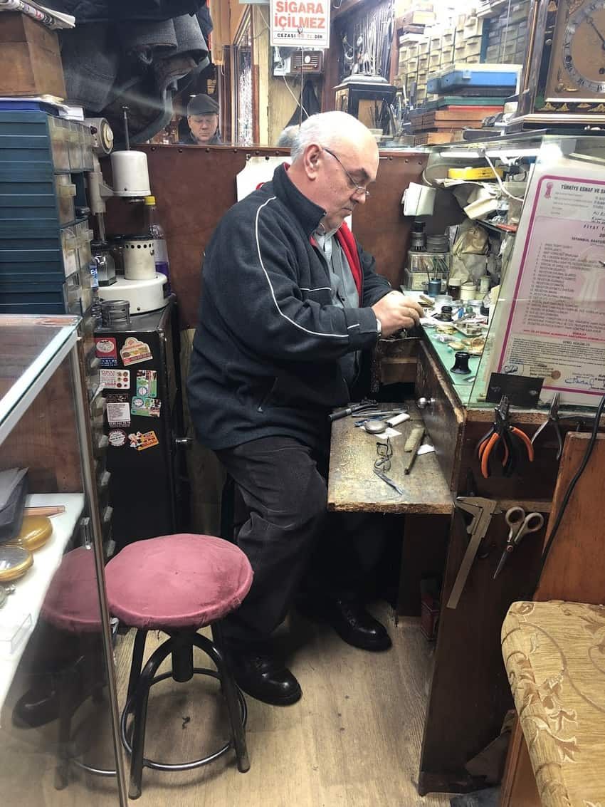 A watchmaker repairing a watch in Istanbul's Grand Bazaar. Max Hartshorne photo.