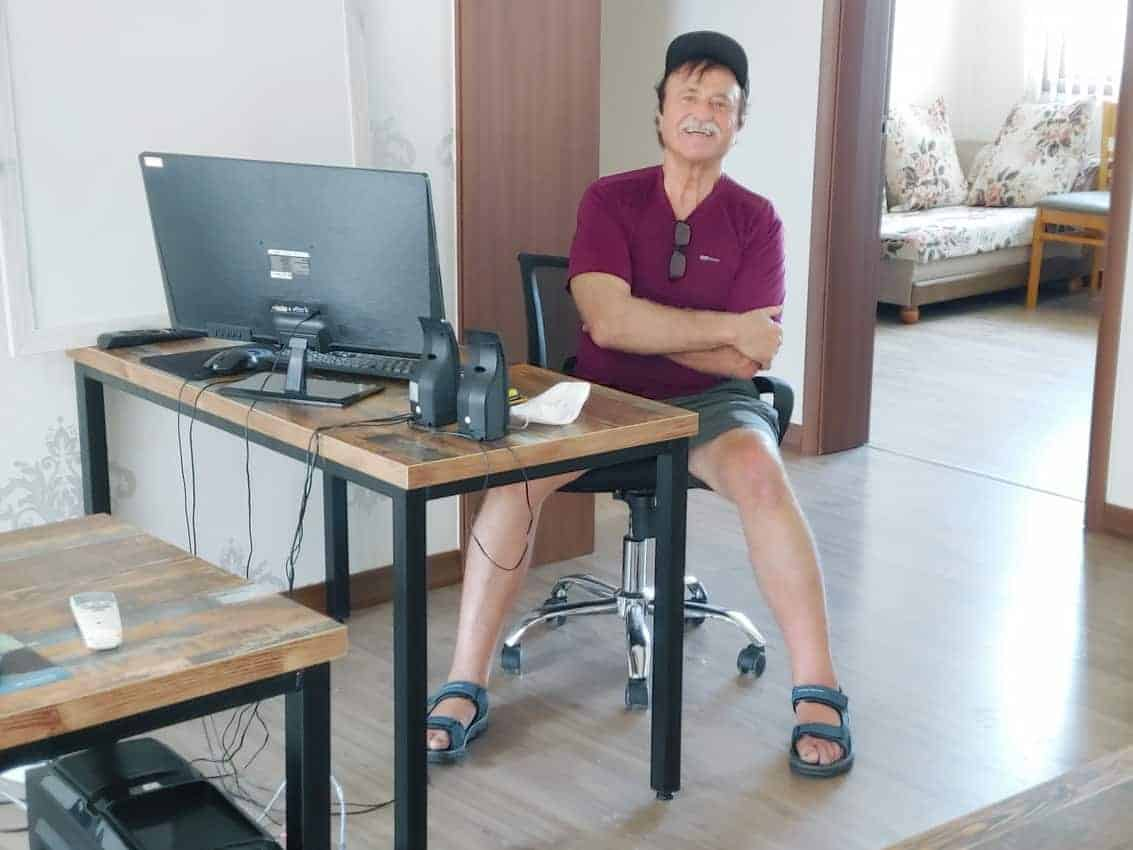 The author taking a break from writing in his South Korean prison.