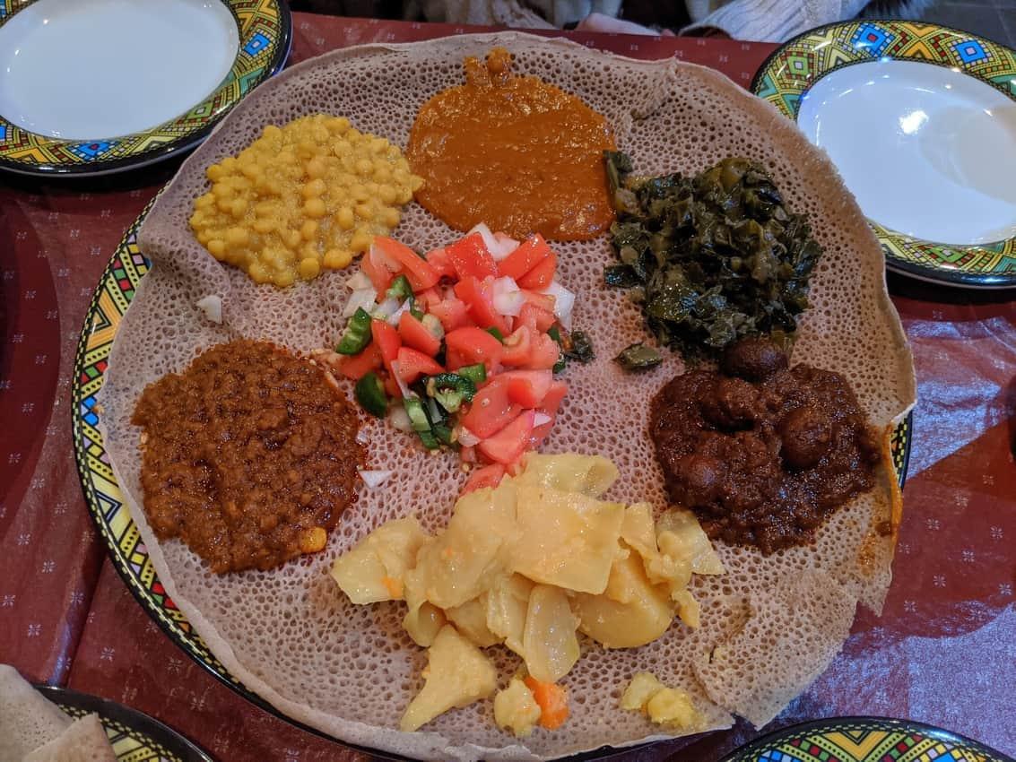Ethiopian food with injera below.
