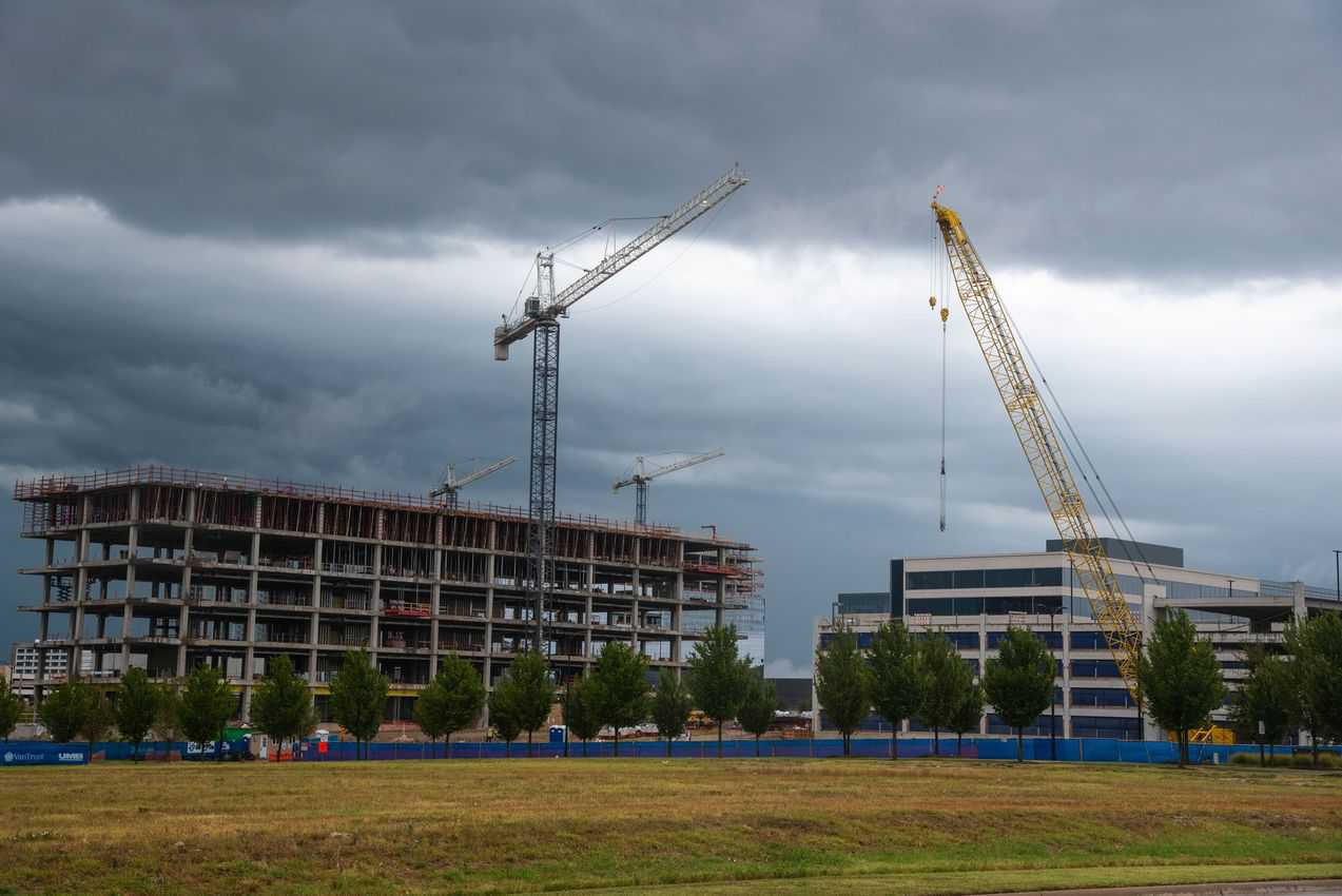 Construction cranes at work on two office buildings in Frisco Star district.