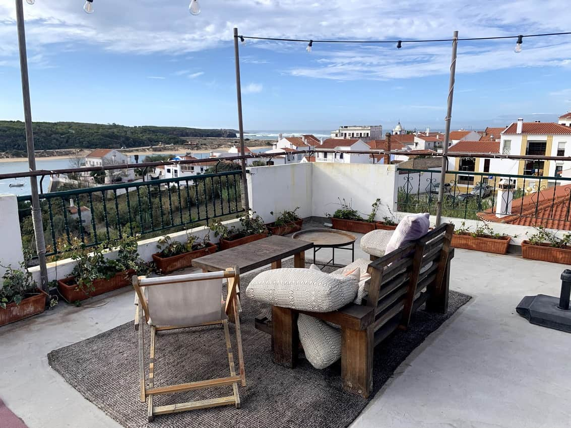 The communal terrace of the Selina Milfontes Hotel and Hostel with amazing views of the town, ocean and river.