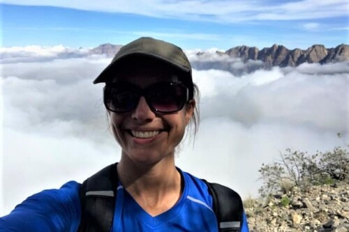 Erin Coyle floating on top of the mountain in Wakan