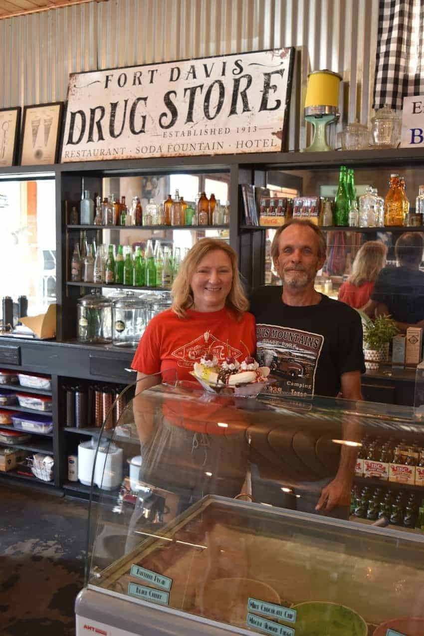 Jennifer and Richard Harrod, owners of the Fort Davis Drug Store and Hotel with their classic banana split