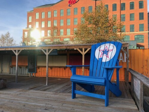 Constitution Yards with a 12-foot high chair, ax throwing and beer gardens in Wilmington Delaware.