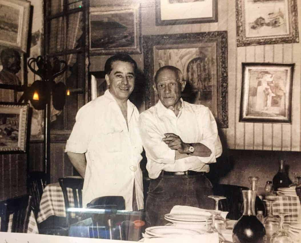 Patrick O'Brian and Pablo Picasso in the Hotel es Templiers bar in France.