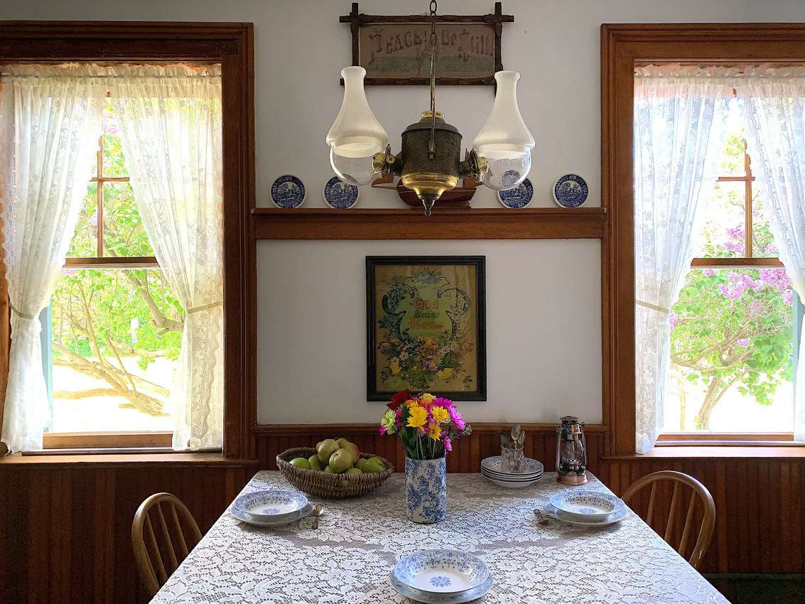 The small dining room table offers a nice window view.
