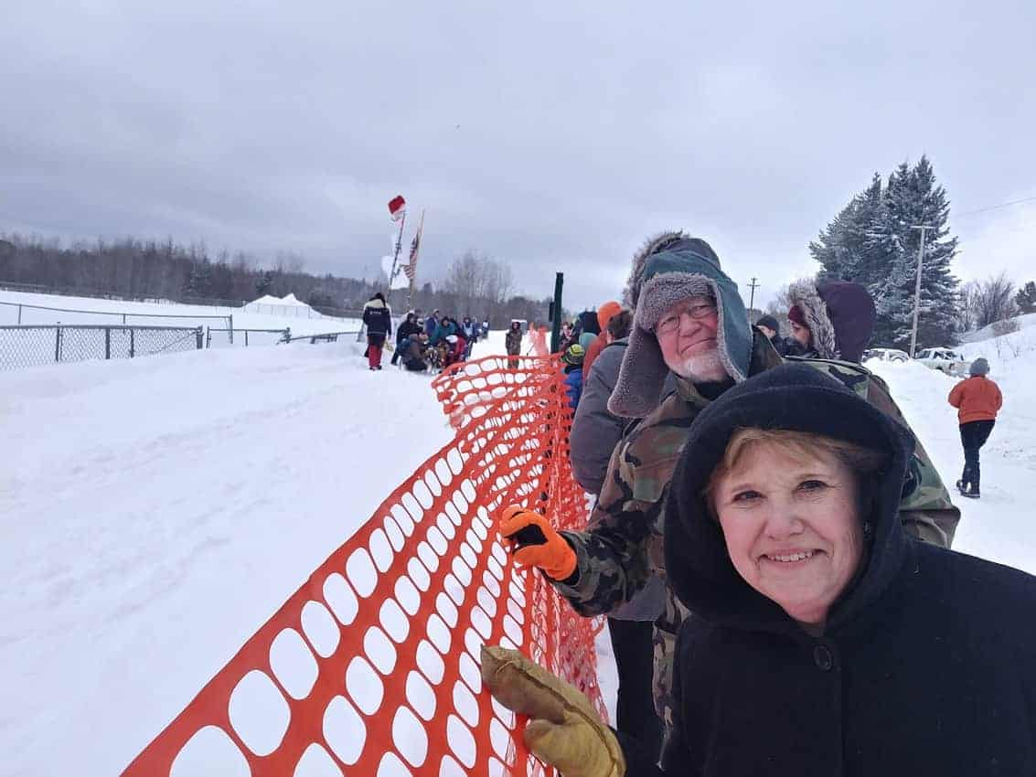 Spectators line up to watch teams take off at Wolf Track Classic Sled Dog Race.