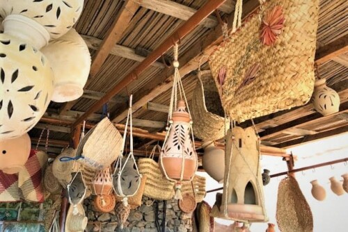 pottery and traditional wicker bags at the shop in Misfat Al Abriyeen, Oman.