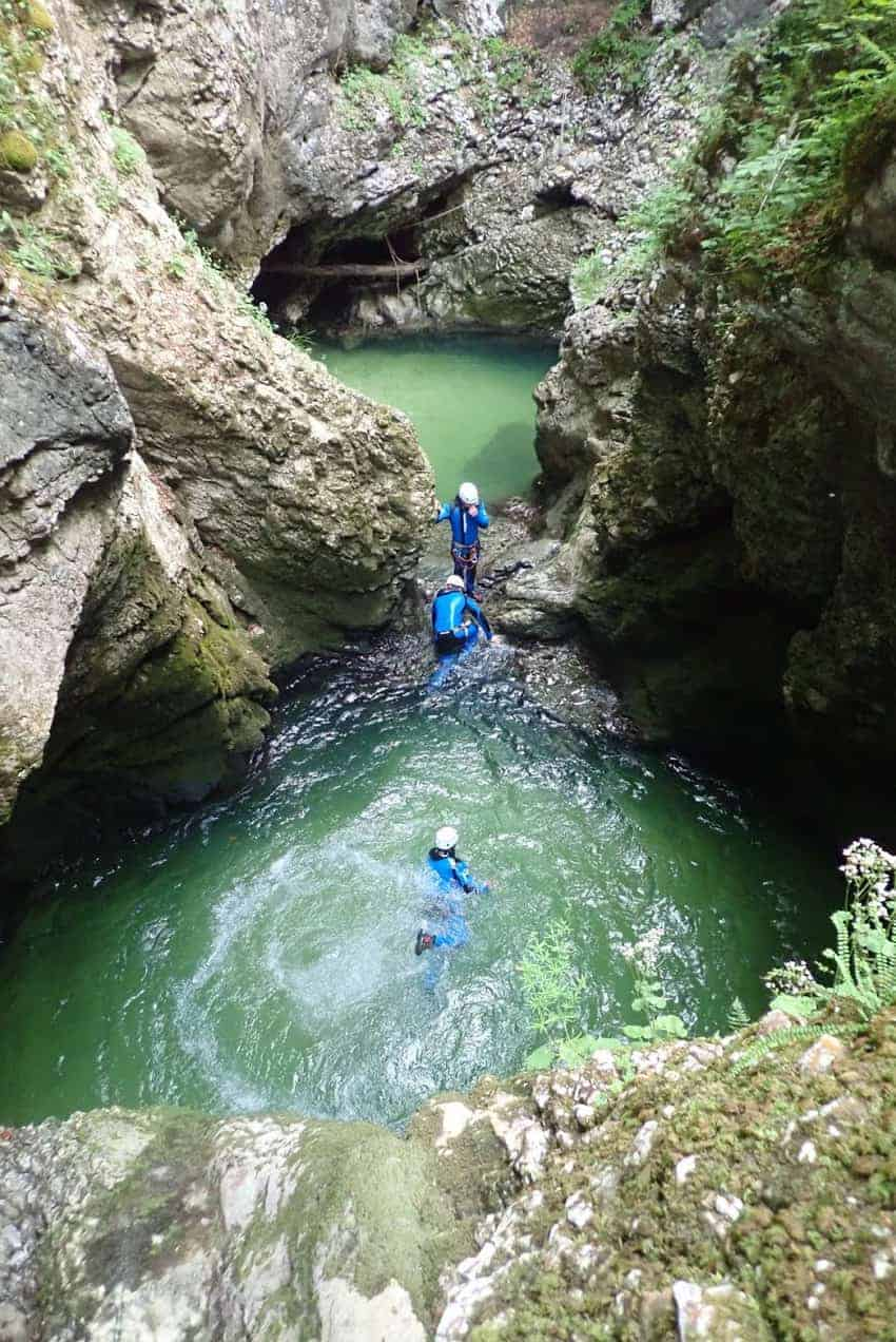 swimming through chilly rock pools canyoning in Slovenia