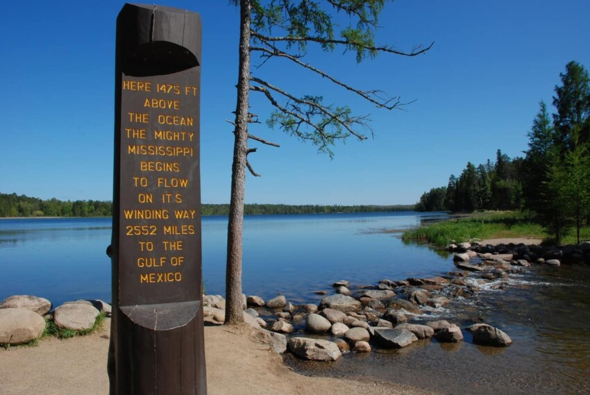 A sign showing how the Mississippi River starts right here on Lake Itasca.