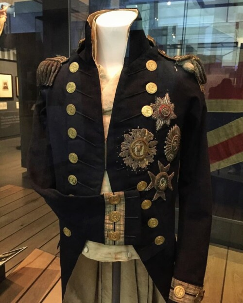 The uniform Nelson was wearing when he was shot and killed at the battle of Trafalgar. You can see the bullet hole by his left shoulder. The bullet, fired from above by a French sniper, went down and penetrated Nelson's spine.