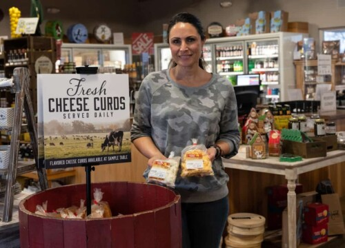 Franca Bueno holds bags of Renard's signature hand-crafted cheese curds in Sturgeon Bay Wisconsin.