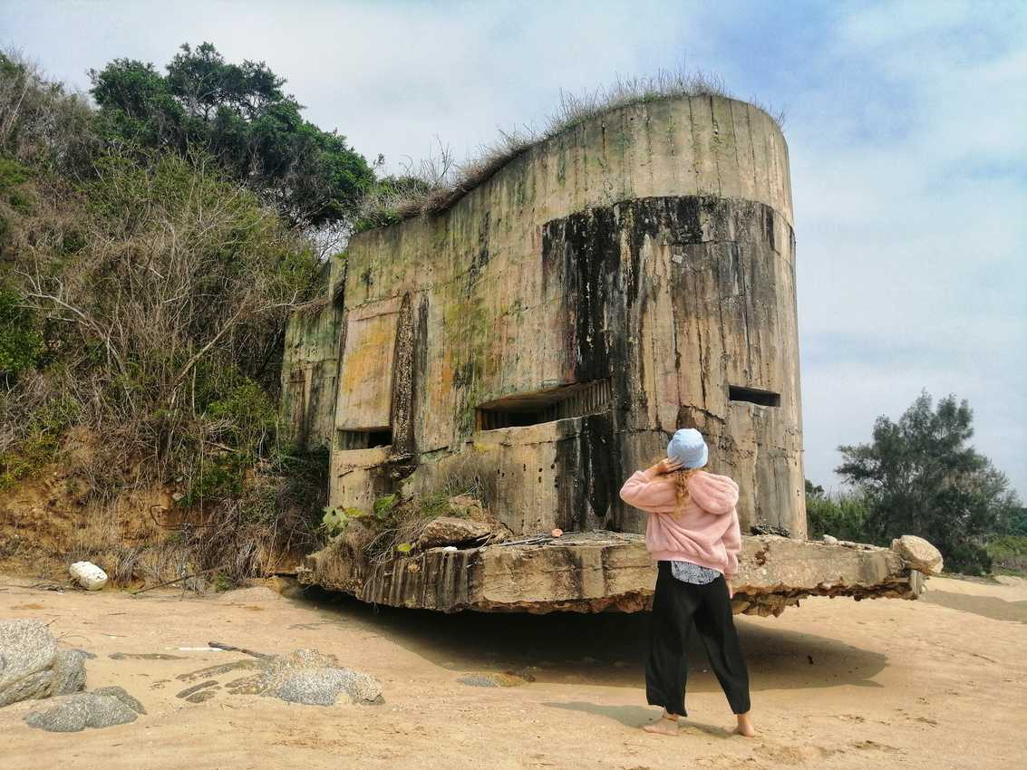 A machine gun bunker sticks out from Kinmen Island's granite hills onto the beach