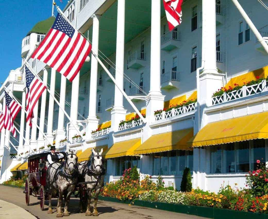 A coach waits for passengers in front of the Grand Hotel on Mackinac Island