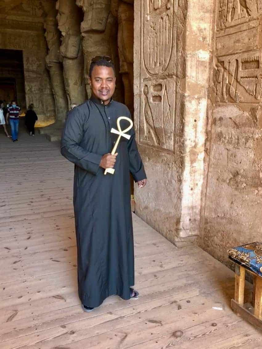 The guardian of the temple holding the heavy gold key to the Great Temple, shaped in the form of an Ankh, the ancient Egyptian hieroglyphic symbol of life.