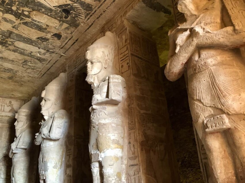 The Osiris Statues carrying crook and flail in the hypostyle hall. The southern pillars wear the Upper Egypt crown, while the northern ones wear the double crown of Upper and Lower Egypt.