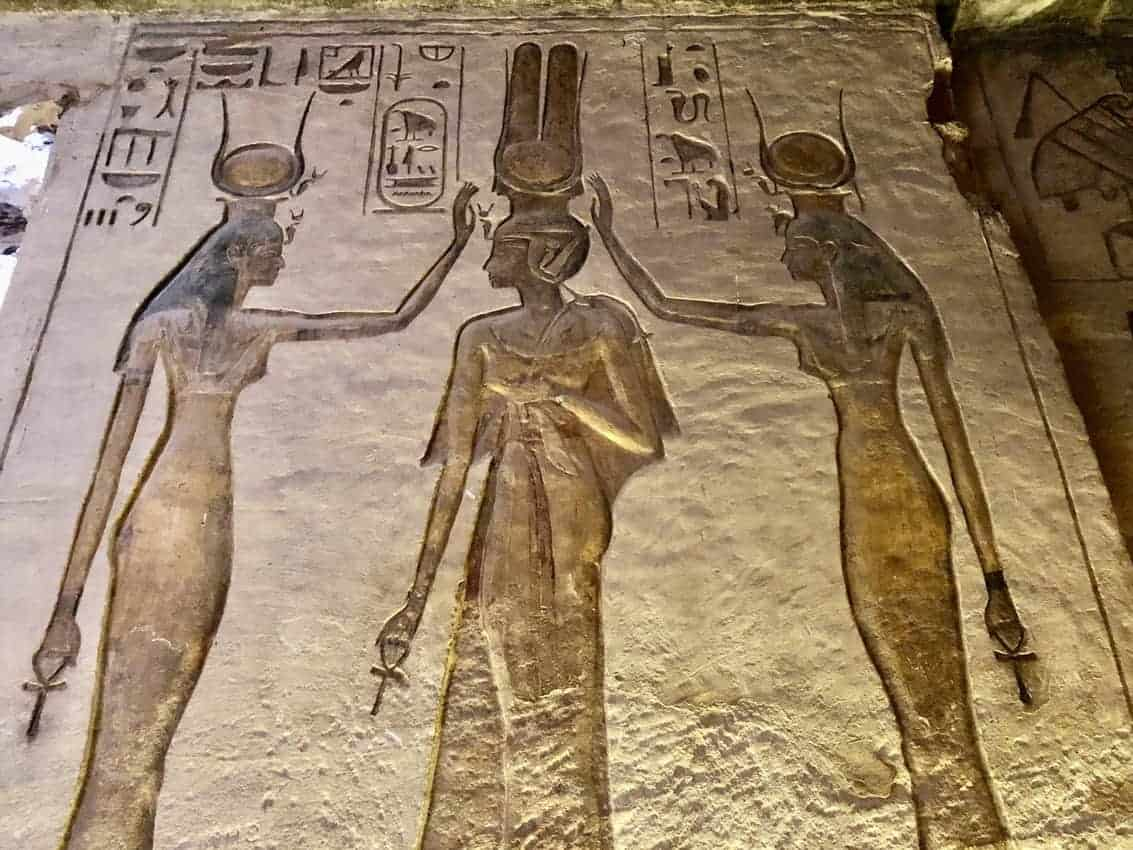 Goddess Isis and Goddess Hathor are blessing Queen Nefertari, while each have an Ankh, the symbol of life in their hand.