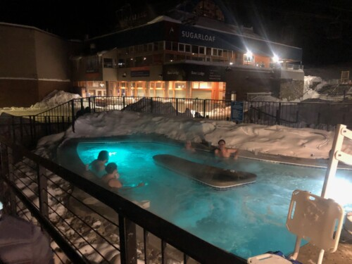 The toasty outdoor hot tub at the Sugarloaf Mountain Hotel in Maine.