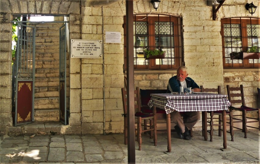 man at the table in a village in the Athamanic Mountains.