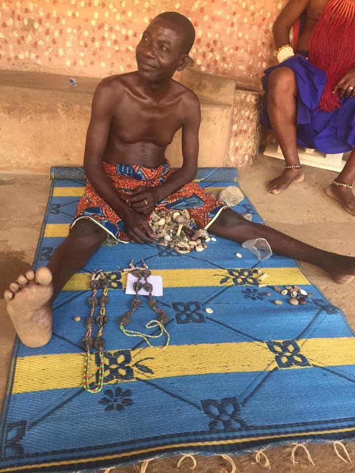 A priest in Klikor, a small town in the Volta region, gave my friend a reading of her future with chosen amulets splayed out in front of him.