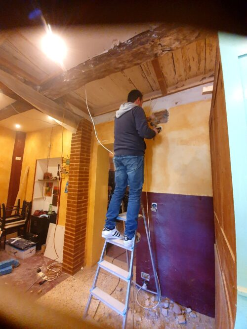 Simon working on the new apartment in Offida, Italy.