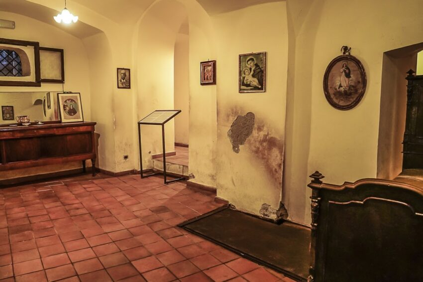 """Inside one of the """"bassi"""" (little apartments) where under the door on the floor leads to the back stage of the theater."""