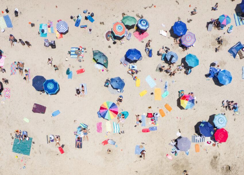 Color and shapes splash across the sandy Salt Creek Beach as vacationers enjoy the hot, sunny day. Salt Creek Beach, Dana Point, CA