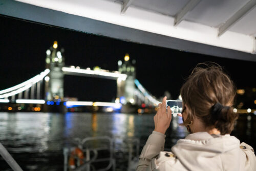 Woman capturing the view. Uber Boat by Thames Clipper Photos.