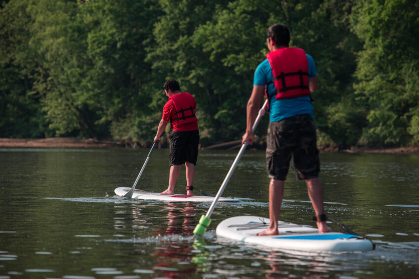 Brothers paddle boarding. Visit Prince Williams Virginia.