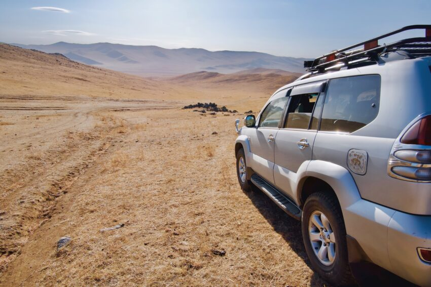 Our vehicle in the middle of the Mongolian countryside. After the first half hour of driving, we pulled off the road and proceeded across country. The colonel seemed to pick a direction at random, leading us through rivers and over hills.