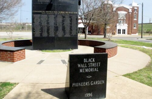 Black Wall Street Memorial with historic Vernon A M E Church in background Photo by Beth Reiber