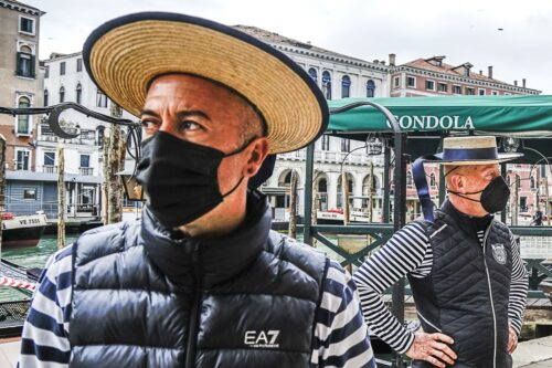 Gondoliers wait for customers in Venice.