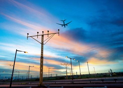 Plane flying over sunset. Hong Kong International Airport Photos.
