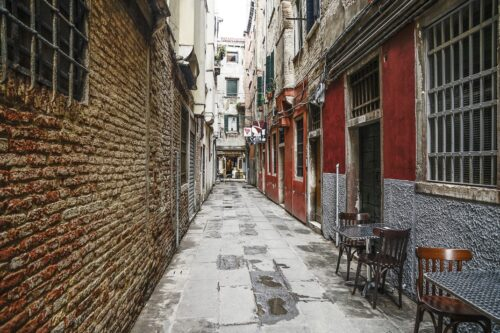 An empty alleyway in Venice, a rare site before covid.