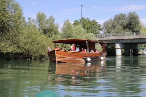 A lovely wooden river barge also gives river cruises.