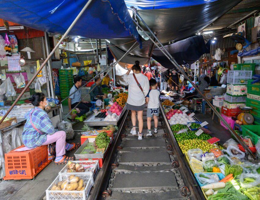 Railway Market, where vendors coexist with the train tracks in Bangkok.
