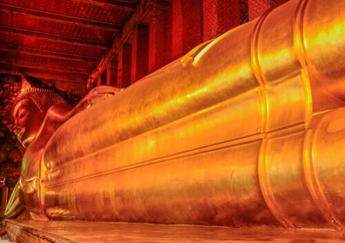 Wat Pho is home to the largest reclining Buddha in Thailand at 151 feet long, and covered in gold leaf.