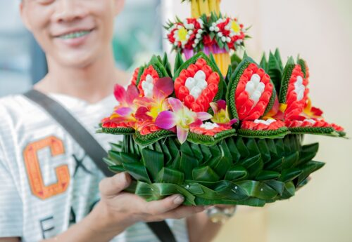 Bamboo leaves are often incorporated into elaborate bouquets available at Bangkok's flower market.