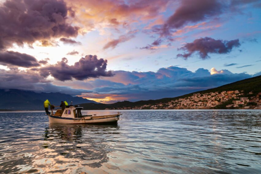 Fishermen in action at sunrise in the Bay of Tivat, Montenegro.