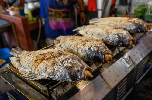 Grilled fish is a specialty at the Amapawa Floating Market.